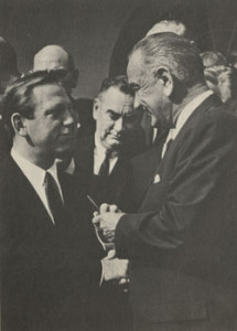 President Lyndon Johnson gives Brademas the pen he used to sign into law the bill that created the NEA and NEH.